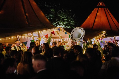 Crazy festival themed wedding with new york brass band