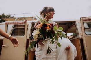 Bridal bouquet and wedding camper van