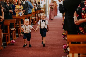 Pageboys coming down the aisle