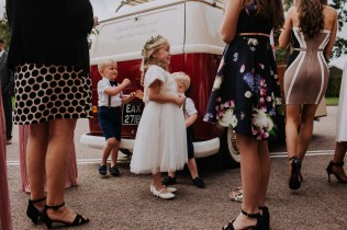 Wedding guests around the camper van