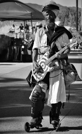 Guitar-player/T-shirt vendor.