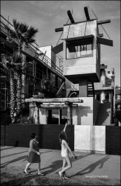 Women admiring the famous beach house designed by Frank Gehry. Venice Beach.