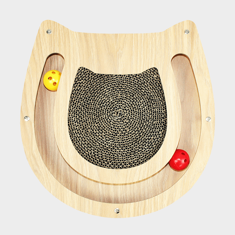 Top view Moggy cat scratcher by Happy Pet Wood cutout in the shape of a cat with a ball rail with one red and one yellow ball each, filled with cardboard in the middle