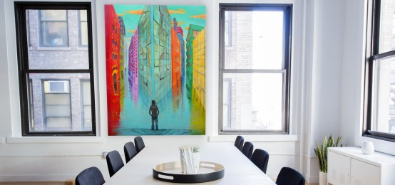 Drowning, an original surreal oil painting by Aalia Rahman, hung up in office space