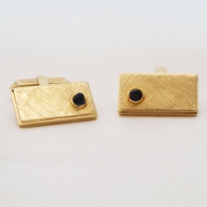 Goldene Manschettenknöpfe mit Saphir