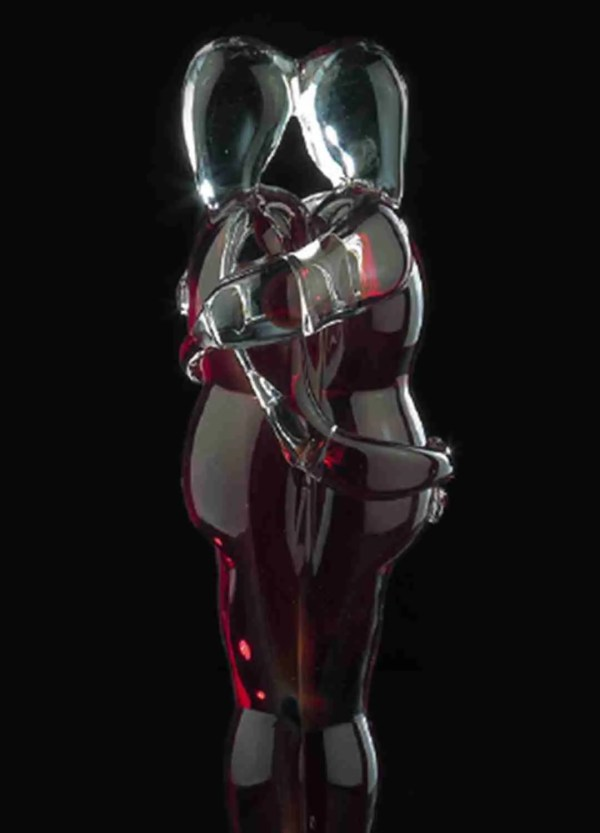 Murano glass couple of lovers sculpture on transparent glass sphere with bubbles. The color of the sculpture is in crystal and red.