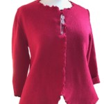 This red fitted wool jacket has a back peplum together with an attractive ruched edging handmade by Sandra Hardy