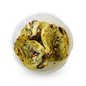 Marinated grilled artichokes halves with herbs in oil
