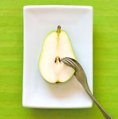Knork fork and knife in one cutting an apple