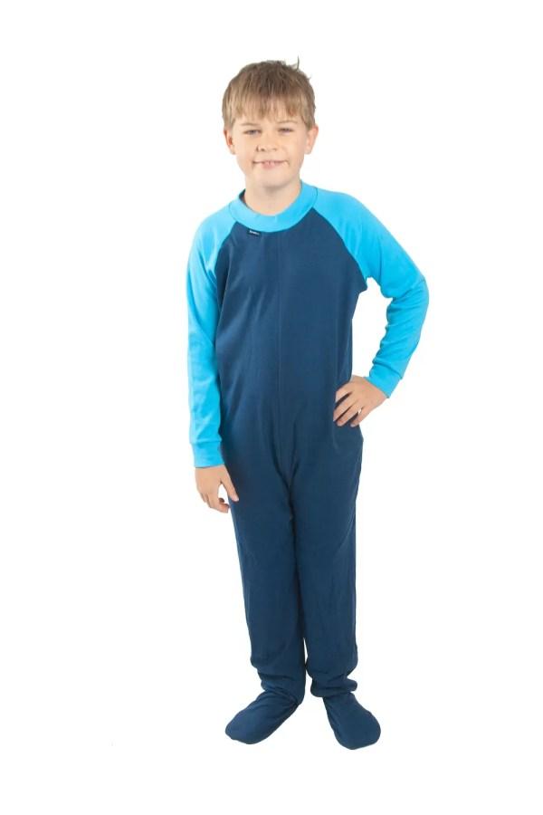 Young boy standing wearing Seenin children's turquoise and navy zip sleepsuit