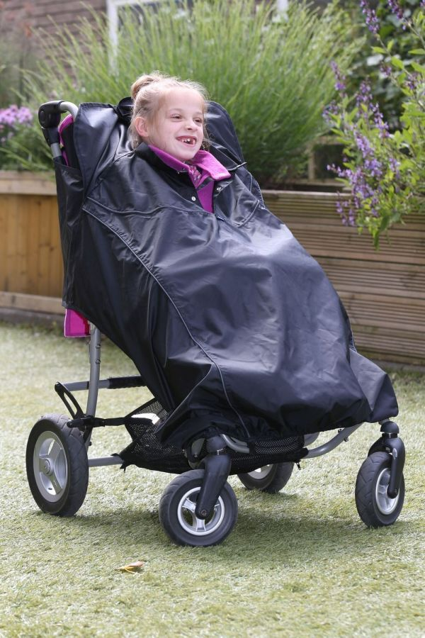 Disabled girl wearing black Seenin total waterproof wheelchair cover