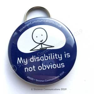 "Image is a photograph of a blue, round keyring with a smiling stickman illustration, with text which reads: ""My disability is not obvious"""