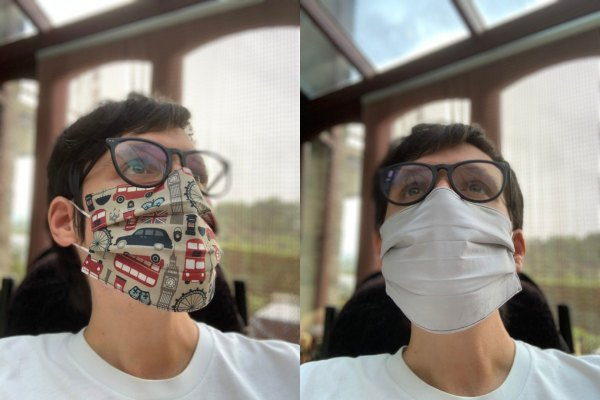 Image is two photographs side-by-side, of a man wearing a London-themed fabric face mask. In the first photograph his head is turned slightly to the right to show the design and fit of the mask. The fabric's design features London buses, black cabs, Big Ben and other iconic London imagery. In the second image the man is facing the camera but looking upwards slightly, and he is wearing the mask inside-out to illustrate that the inner lining is white in colour.