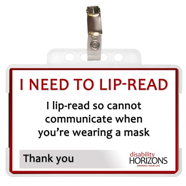 "Image is a photograph of a lip-reading ID card in a plastic case with badge clip. Text on the ID card reads: ""I NEED TO LIP-READ. I lip-read so cannot communicate when you're wearing a mask. Thank you"""