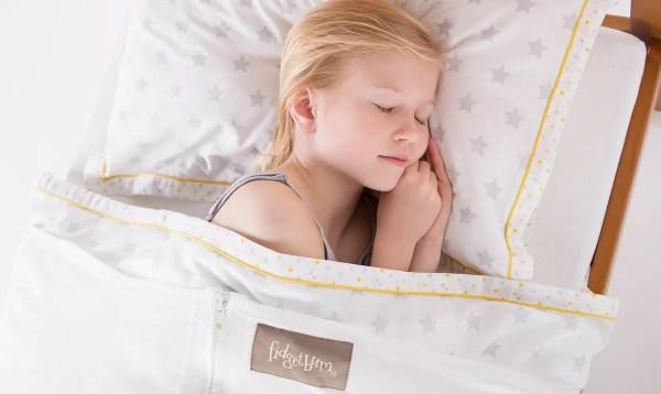 Child asleep under the fidgetbum