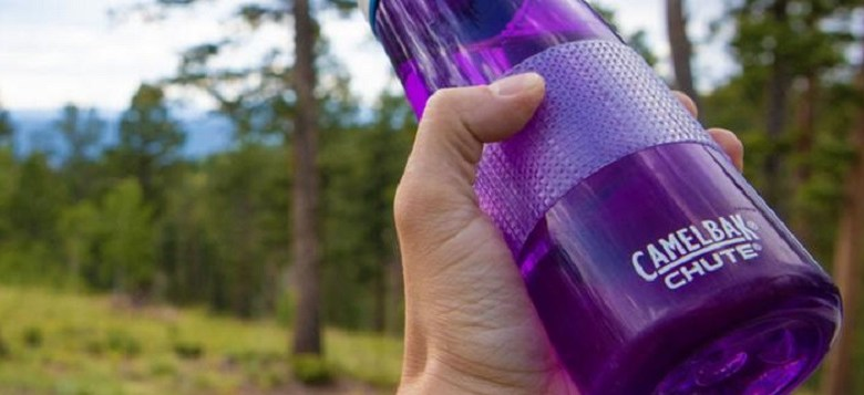 Cat Tongue non-abrasive grip tape on a water bottle being held