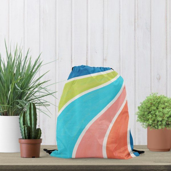 Fruity Swirl Drawstring Bag on Table with Plants