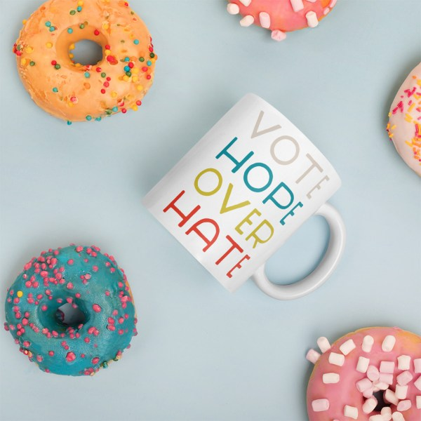 11oz vote hope mug surrounded by donuts