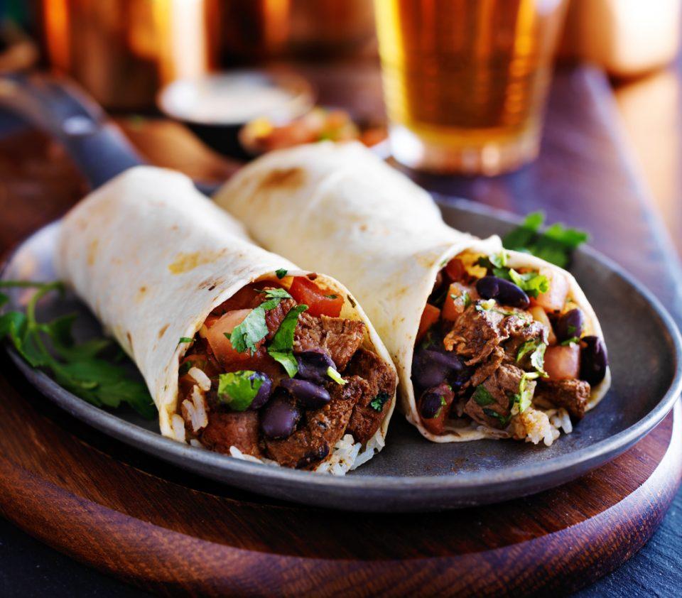 two beef steak burritos