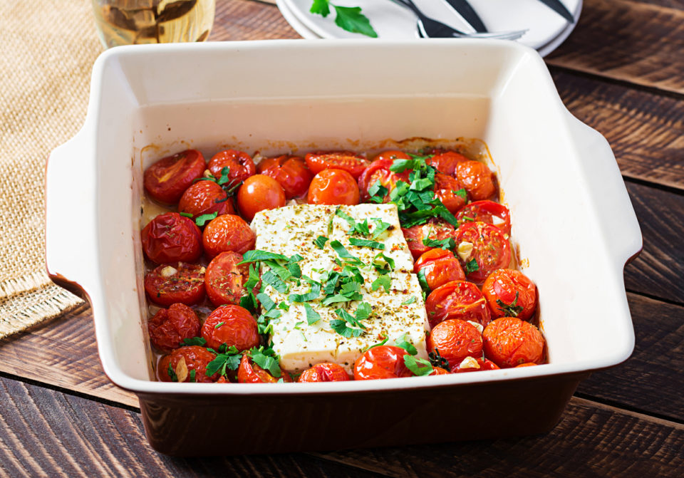 Trending Feta bake pasta recipe made of cherry tomatoes, feta cheese, garlic and herbs.