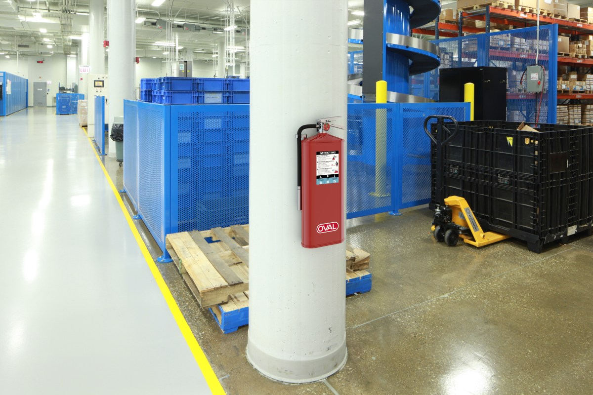 Oval Brand Fire Extinguisher Model 10HABC installed on a Factory Column