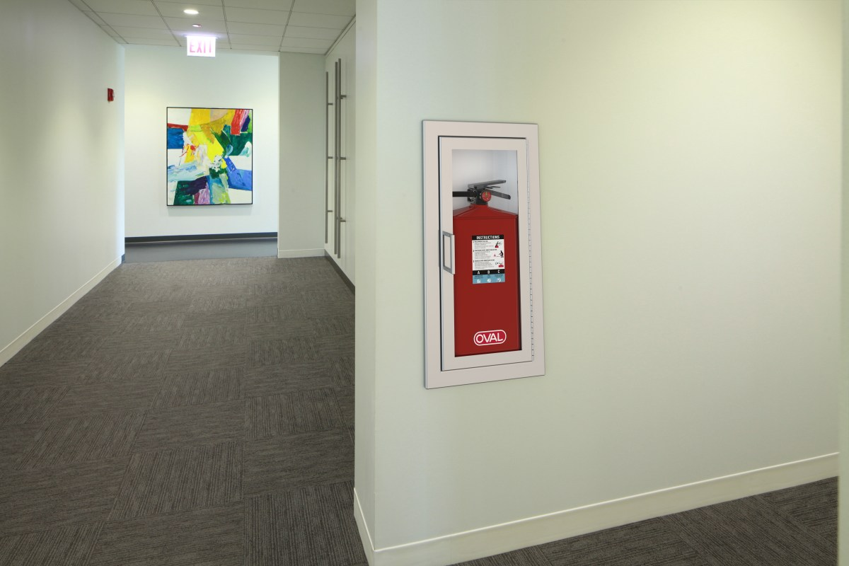 Oval Brand Fire Extinguisher Model 10JABC installed in a Hallway