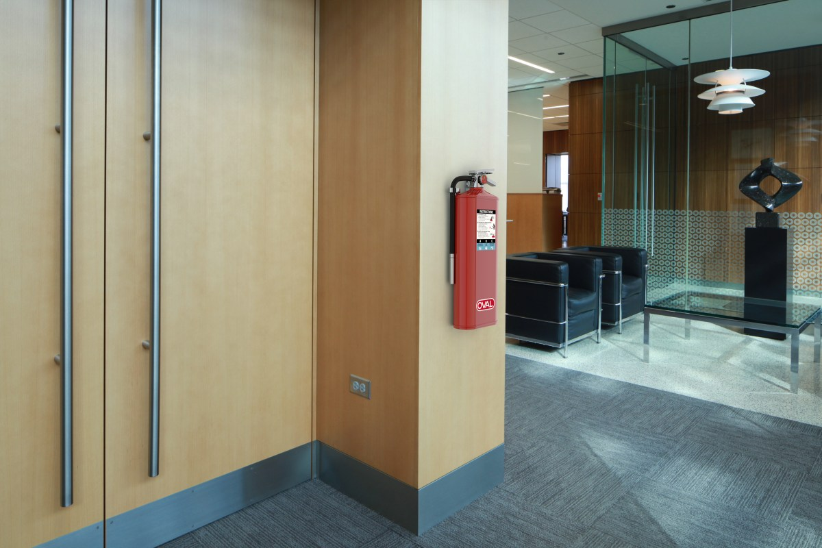 Oval Brand Fire Extinguisher Model 10HABC installed in a Second Floor Reception