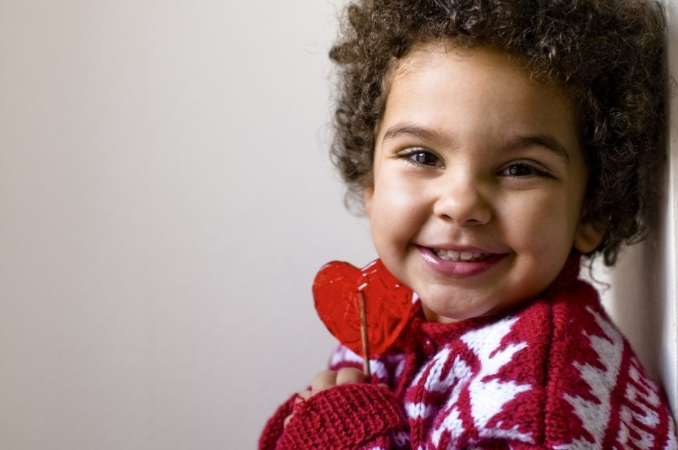 Happy Child Holding Tight Her Heart Shaped Valentine's Day Lollipop