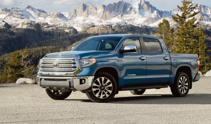 blue Tundra truck in front of mountain range