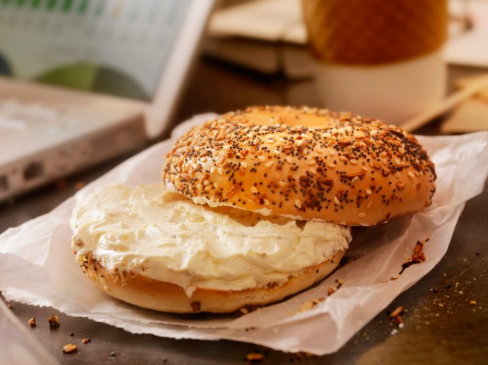Bagel and cream cheese with coffee