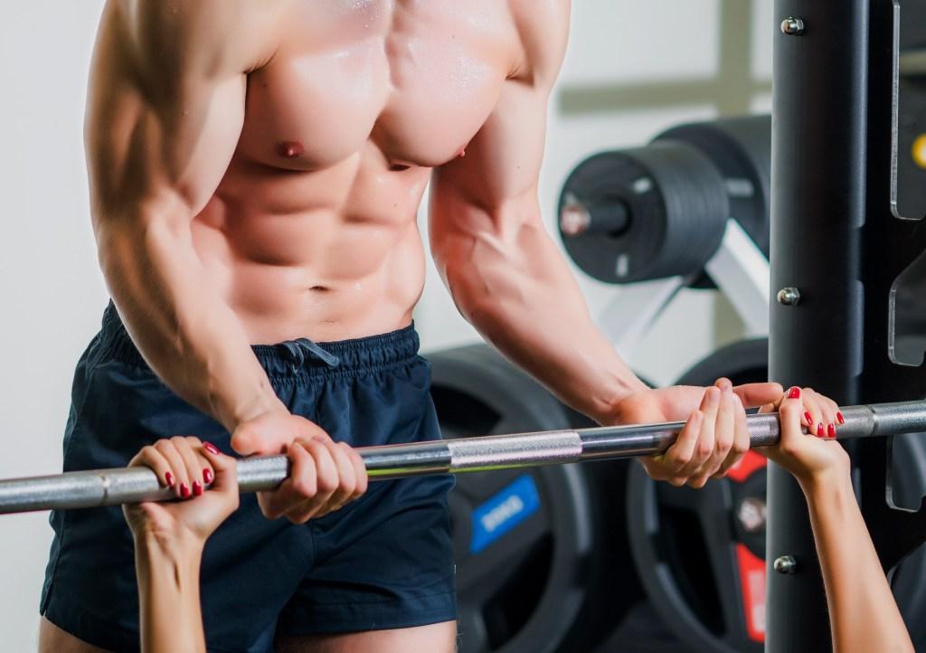 A trainer helping a client reach their goals