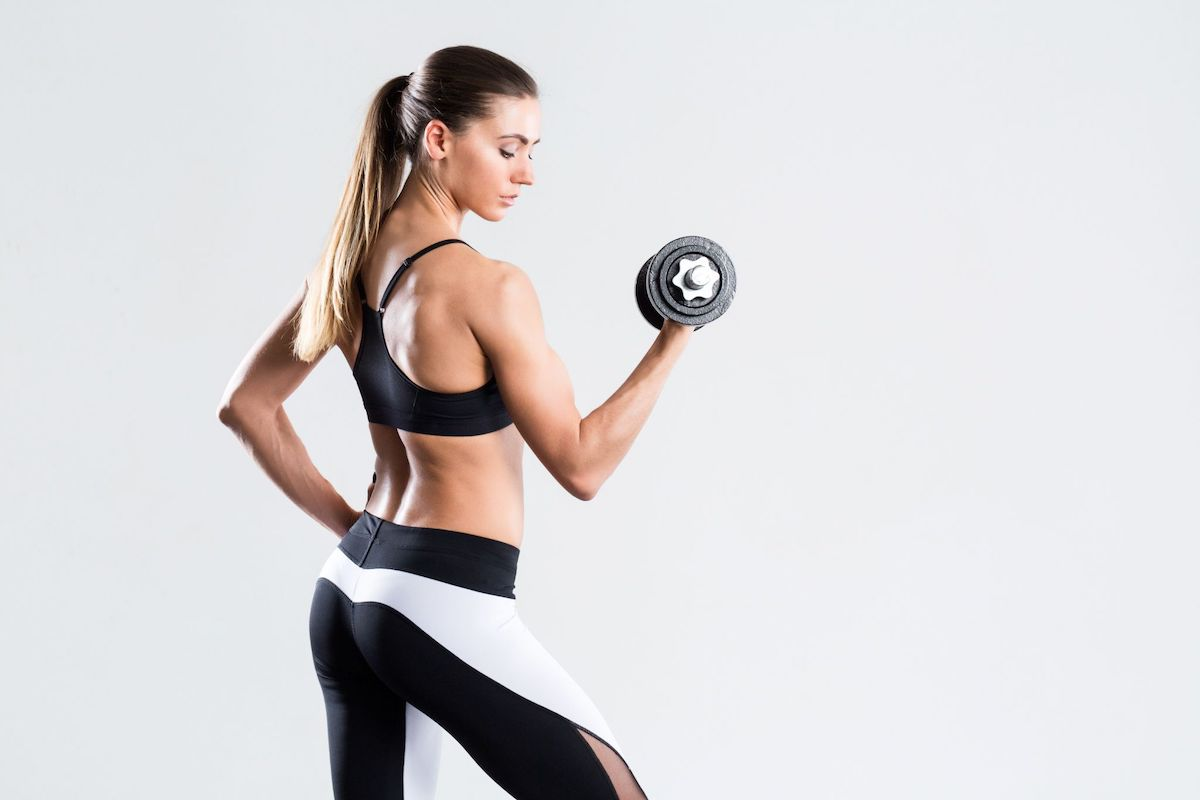Dumbbell Punch. Woman doing arm curls.