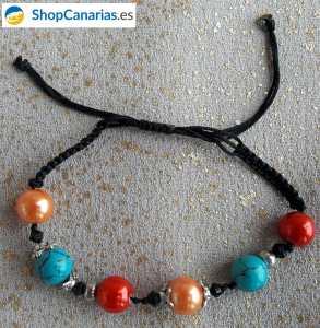 Pulsera ShopCanarias.es de macramé naranja, turquesa y rojo
