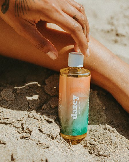 dune body oil on the beach