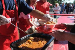 A line of customers wait as Apple Valley Fire Fighter Steve Schendel serves up bowls of Booya at the fire station 1 during the 34th Annual Booya fundraiser at station 1 in Apple Valley on September 15, 2012. (Pioneer Press: Sherri LaRose-Chiglo)