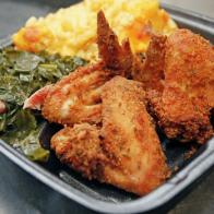 This Daran's Southern Soul Food and West Indian Cuisine meal consists of fried chicken, collard greens and baked mac and cheese. David Samson / The Forum