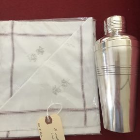 The perfect combination for the discerning man on your gift list: a set of antique monogrammed cocktail napkins and a silver shaker!