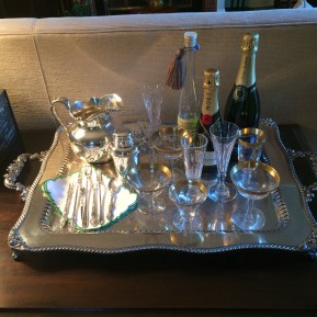 Antique silver completes the at-home bar of a Folie à Trois follower.