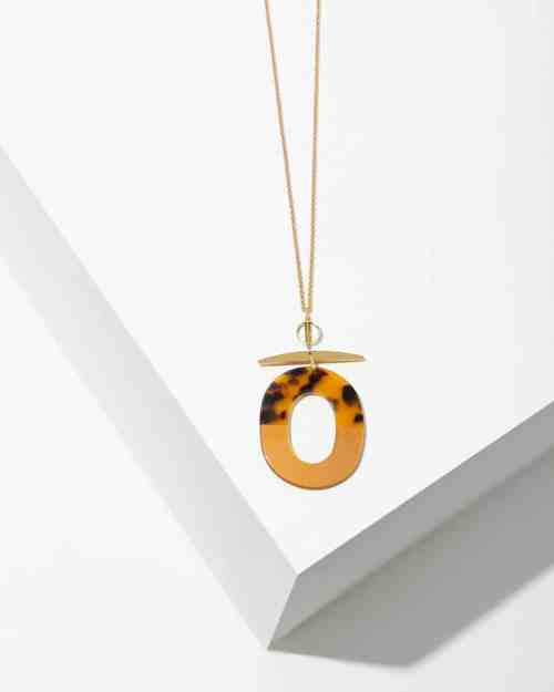 A leapord stone necklace on a gold chain