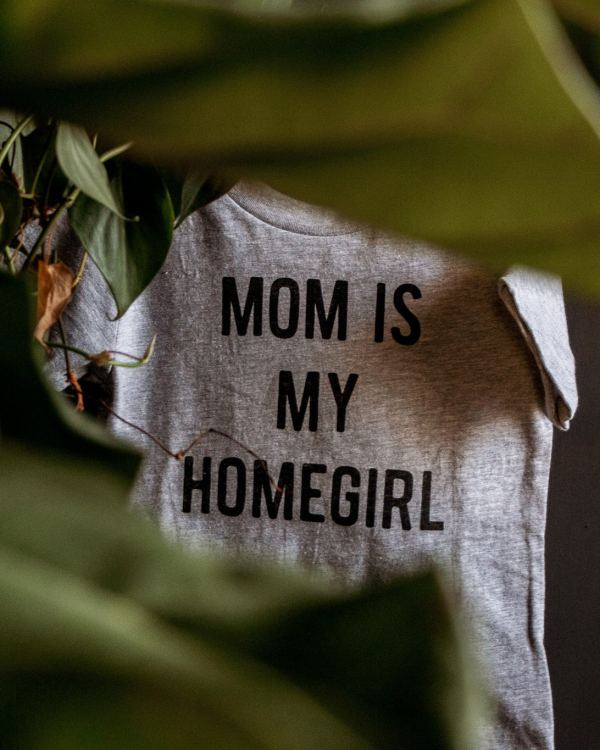 this is a photo of a light grey kids tee that says mom is my homegirl in black ink