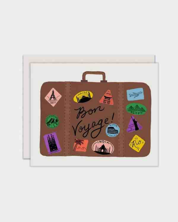 White card with a suitcase on it that says 'bon voyage'