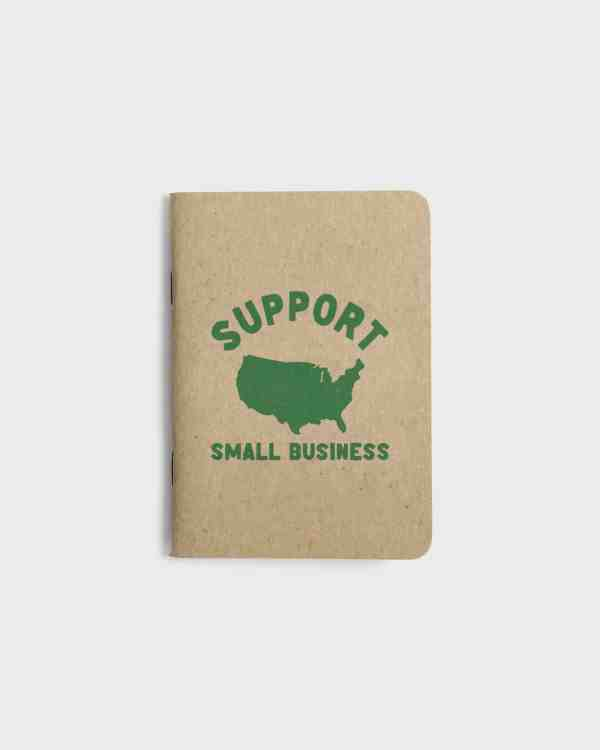 Small kraft paper notebook with screen printed cover. Support USA small business graphic printed in green ink.