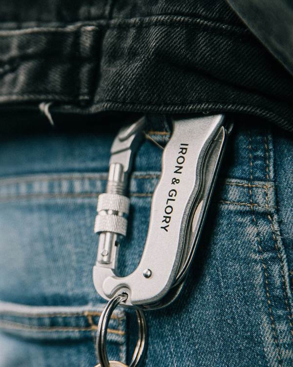 A carabiner tool clipped onto a belt loop