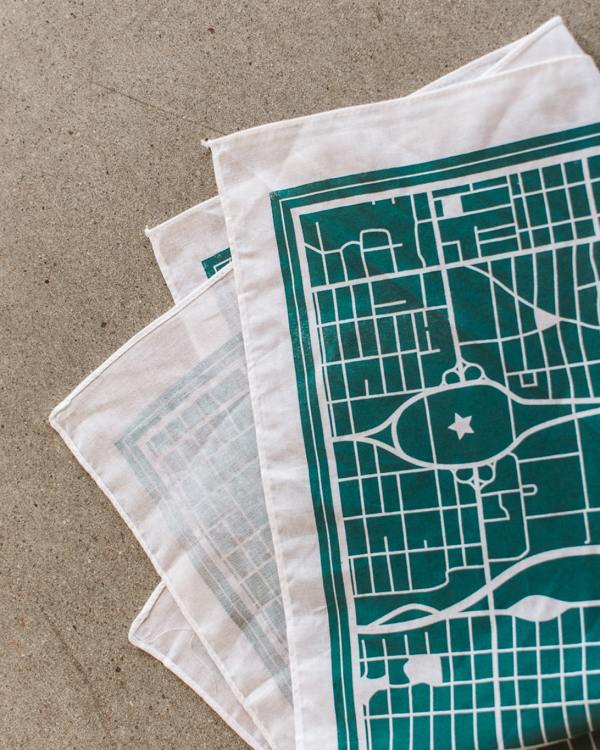 A white bandana with a teal art print of the Oklahoma City Street system.