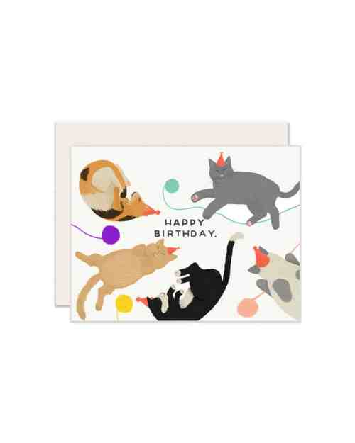 A white card with cats on the front and text that reads Happy Birthday