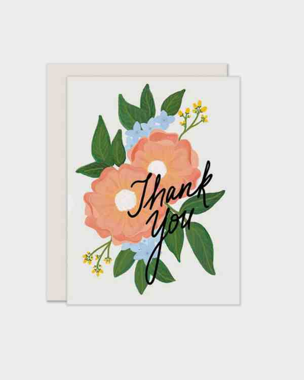 White card with florals on it that says 'thank you'