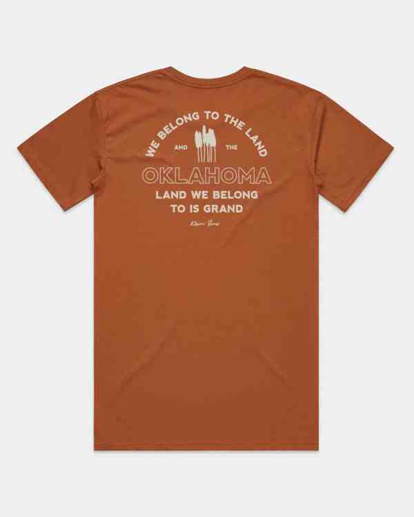 Copper shirt that says We Belong to the Land