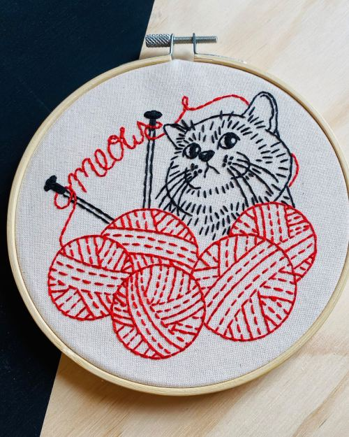 A photo of a red, white and black Knitten Kitten Embroidery Kit