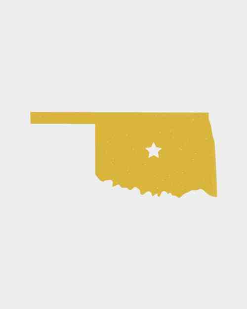 A yellow sticker in the shape of Oklahoma