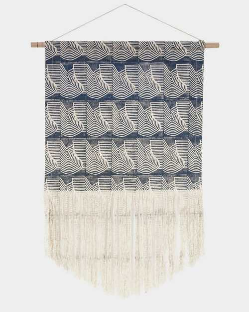 Blue and cream printed wall hanging on wooden rod